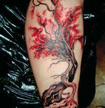 aziatsche kersenbloesem tatoeage geplaats op onderbeen