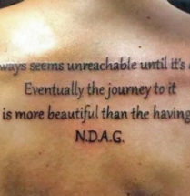 tattoo tekst It always seems inreachable until it's done, Eventually the journey to it is more beautiful than the having. N.D.A.G.