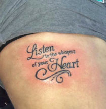 tattoo listen to the whispers of your heart in sierlijke letters