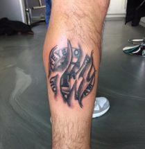 Feyenoord logo op onderbeen