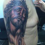 Jezus op bovenarm