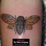Tattoo van een vlieg geplaatst op de arm
