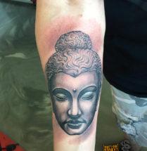 Boeddha op onderarm