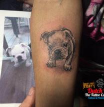 Puppy op onderarm