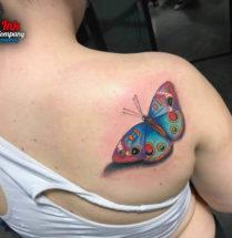Vlinder op schouder